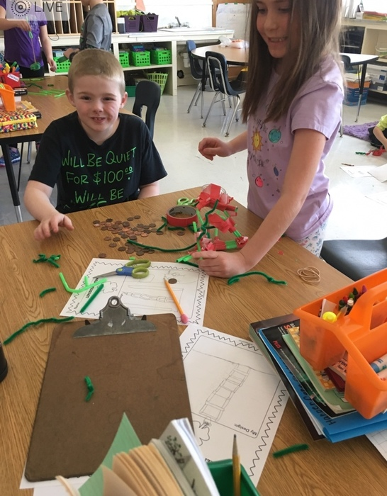 Konner and Harper create a St Pat's Day tower.