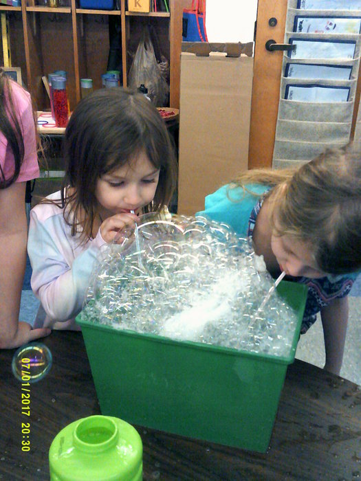 Kaleigh and Rhylie make a bubble mountain!